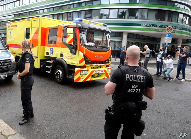 An ambulance which is believed to transport Alexei Navalny arrives at the Charite hospital in Berlin, Germany, Aug.22, 2020.