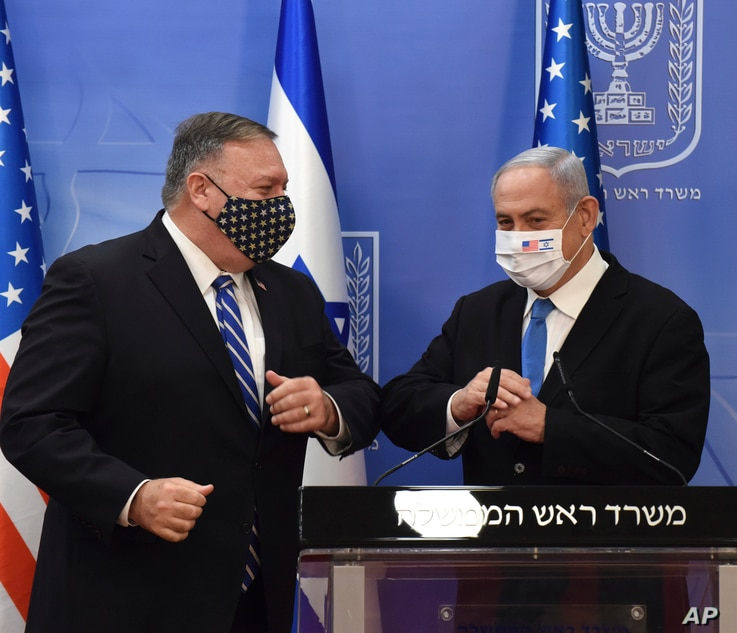 U.S. Secretary of State Mike Pompeo and Israeli Prime Minister Benjamin Netanyahu wear face masks to help prevent the spread of the coronavirus after they make joint statements to the press, in Jerusalem, Aug. 24, 2020.