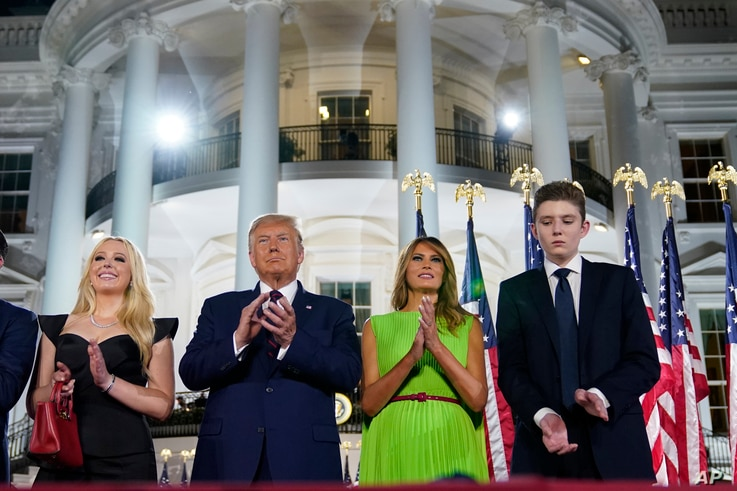 From left, Tiffany Trump, President Donald Trump, first lady Melania Trump and Barron Trump stand on stage on the South Lawn