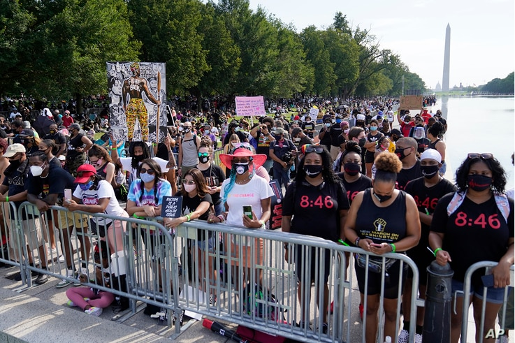 People attend the March on Washington, Aug. 28, 2020, at the Lincoln Memorial in Washington.