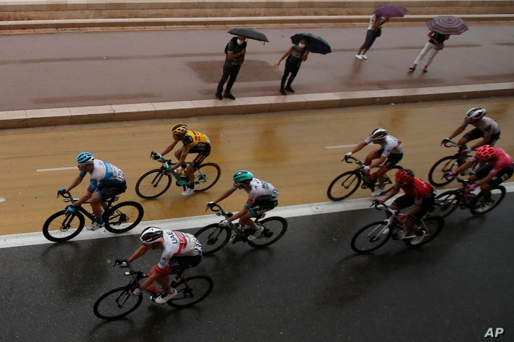 The pack rides during the first stage of the Tour de France cycling race over 156 kilometers (97 miles) with start and finish…