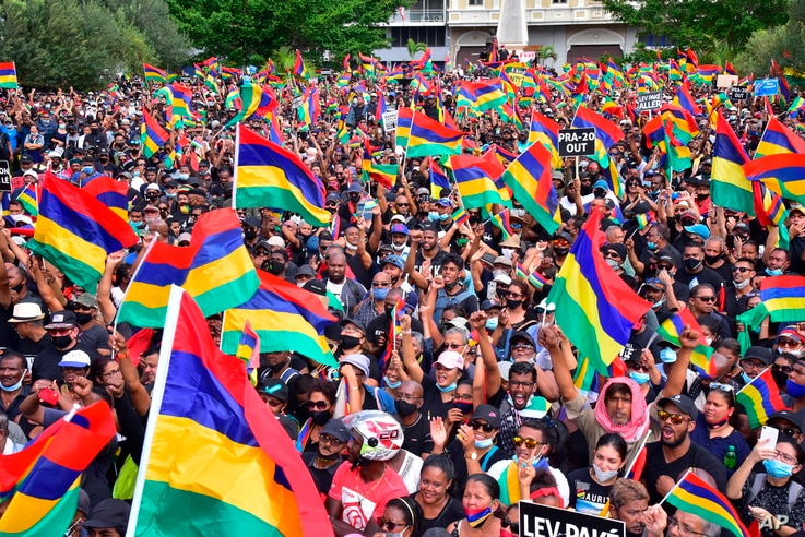 Tens of thousands of people protest in Port Louis, Mauritius, Saturday Aug. 29, 2020, over the government's slow response to an oil spill from a grounded Japanese ship