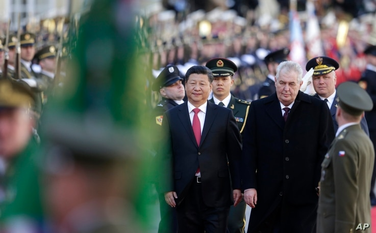 Czech Republic's President Milos Zeman, right, welcomes his Chinese counterpart Xi Jinping, left, at the Prague Castle in…