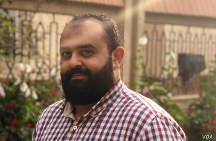Eslam Karam, 33, says he's sad he cannot pray in the mosque or visit relatives this holiday, but adds that his fear of the virus is greater than his need to get out, in Cairo, July 31, 2020. (Hamada Elrasam/VOA)