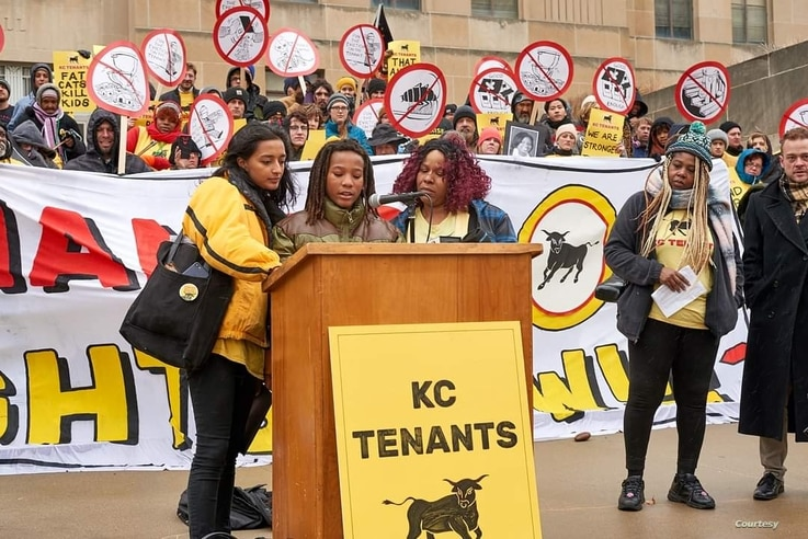 KC Tenants board member Tiana Caldwell (Right) at the podium with her son AJ and director of KC Tenants Tara Raghuveer while he speaks at a KC Tenants rally, pre-COVID.
