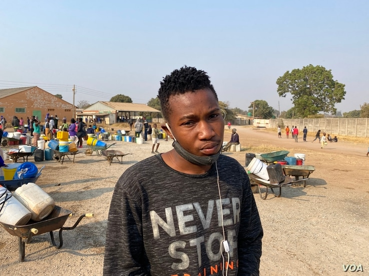 Twenty-three-year-old Chester Musha says he wakes up around 3AM to queue for water or the borehole dries up that day, Harare, Aug. 20, 2020. (Columbus Mavhunga/VOA)