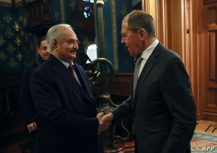 This handout picture released by the Russian Foreign Ministry Jan. 13, 2020, shows Russian Foreign Minister Sergey Lavrov welcoming Libya's military strongman Khalifa Haftar in Moscow.