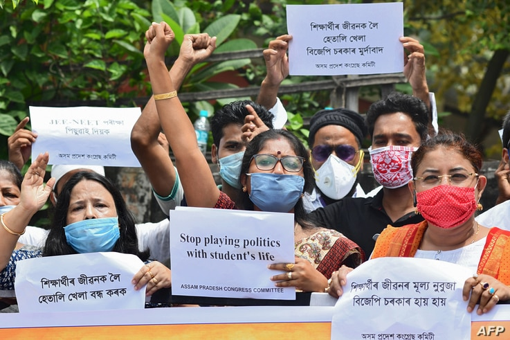Activists of Assam Pradesh Congress Committee (APCC) take part in a prostest demanding the government postpone college entrance exams, in Guwahati, India, Aug. 28, 2020.