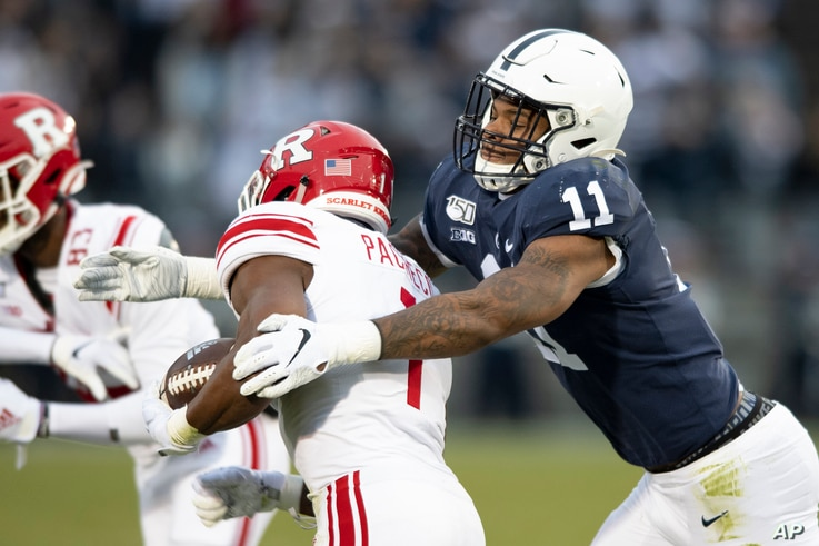 FILE - Penn State linebacker Micah Parsons (11) tackles Rutgers tight end Johnathan Lewis (11) in the first quarter of an NCAA college football game, in State College, Pennsylvania, Nov. 30, 2019.