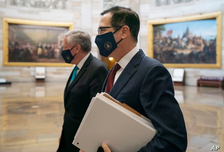 Treasury Secretary Steven Mnuchin and White House chief of staff Mark Meadows, left, walk to House Speaker Nancy Pelosi's office on Capitol Hill in Washington, Aug. 5, 2020.