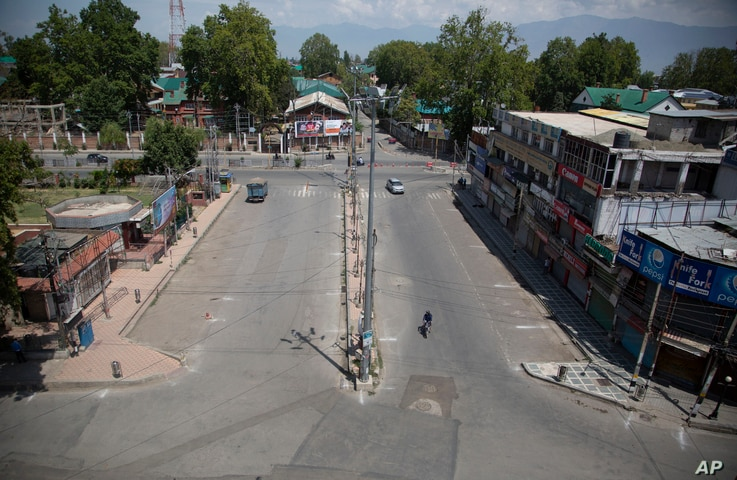 A deserted street is seen during curfew in Srinagar, Indian-controlled Kashmir, Aug. 4, 2020.