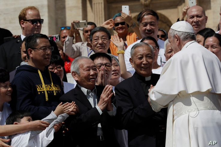 FILE - Pope Francis stops by a group of faithful from Shanghai during his weekly general audience in St. Peter's square, at the Vatican, May 22, 2019.