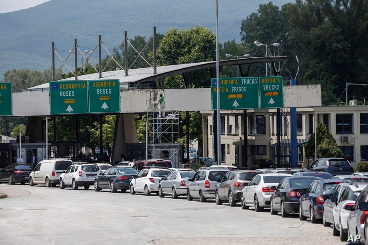 Cars queue at Promahonas border crossing with Bulgaria, which is the only land border into Greece that is open, July 6, 2020.