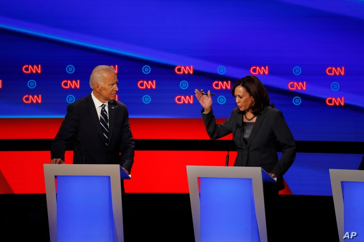 FILE - Sen. Kamala Harris, right, speaks as former Vice President Joe Biden listens during the second of two Democratic presidential primary debates hosted by CNN, July 31, 2019, in the Fox Theatre in Detroit, Michigan.