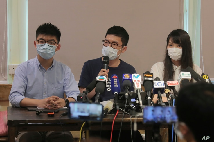 Pro-democracy activists, from left; Joshua Wong, Nathan Law and Agnes Chow attend a press conference in Hong Kong, May 30, 2020.