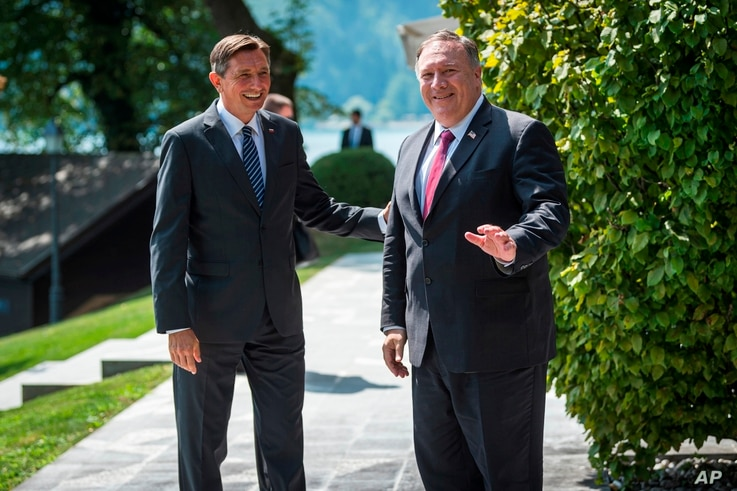 Slovenia's President Borut Pahor, left, welcomes U.S. Secretary of State Mike Pompeo upon his arrival prior to their meeting in Bled, Slovenia, Aug. 13, 2020.