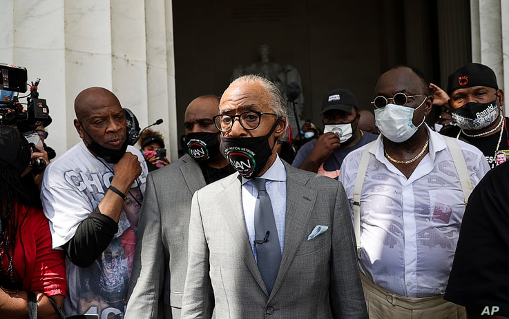 "The Rev. Al Sharpton arrives to speak at the ""Get Your Knee Off Our Necks March,"" in Washington, Aug. 28, 2020, on the 57th anniversary of the Rev. Martin Luther King Jr.'s ""I Have A Dream"" speech."