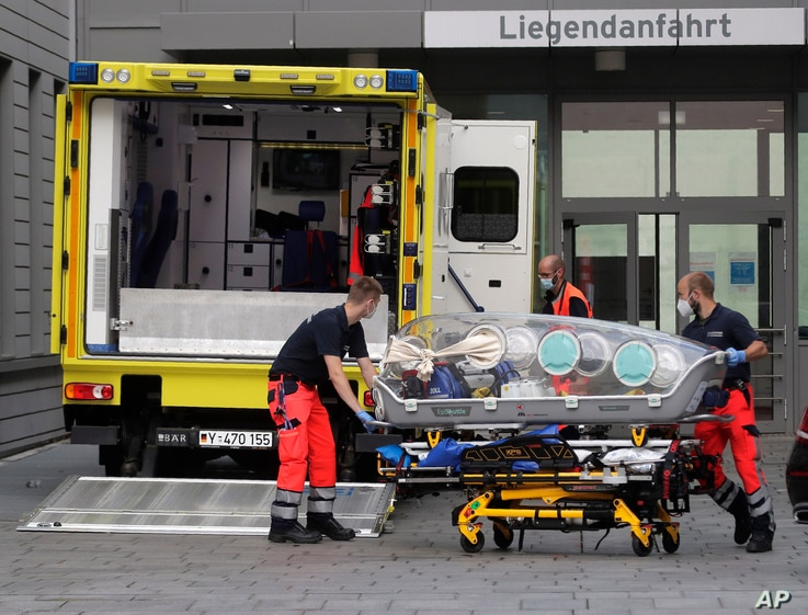 An empty stretcher is moved back into an ambulance which is believed to have transported Alexei Navalny to the Charité Clinic for treatment, in Berlin, Germany, Aug.22, 2020.