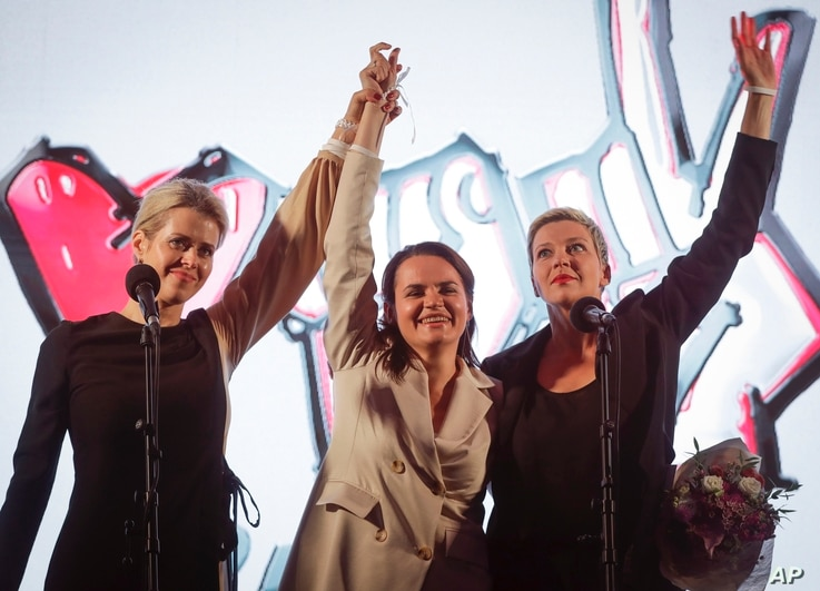 FILE - Sviatlana Tsikhanouskaya, then presidential candidate (C), Veronika Tsepkalo, wife of opposition figure Valery Tsepkalo (L), and Maria Kolesnikova, campaign representative of another opposition candidate, gesture in Minsk, Belarus, July 30, 2020.
