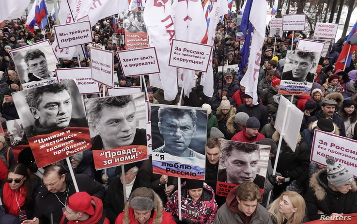 FILE - People attend a rally in memory of Russian opposition politician Boris Nemtsov, who was assassinated in 2015, in Moscow, Russia, Feb. 24, 2019.