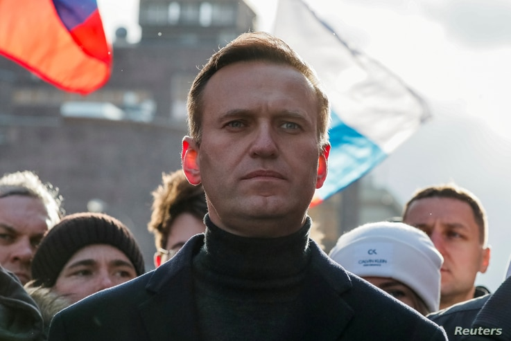 FILE - Russian opposition politician Alexei Navalny takes part in a rally to mark the 5th anniversary of opposition politician Boris Nemtsov's murder and to protest against proposed amendments to the country's constitution, in Moscow, Feb. 29, 2020.