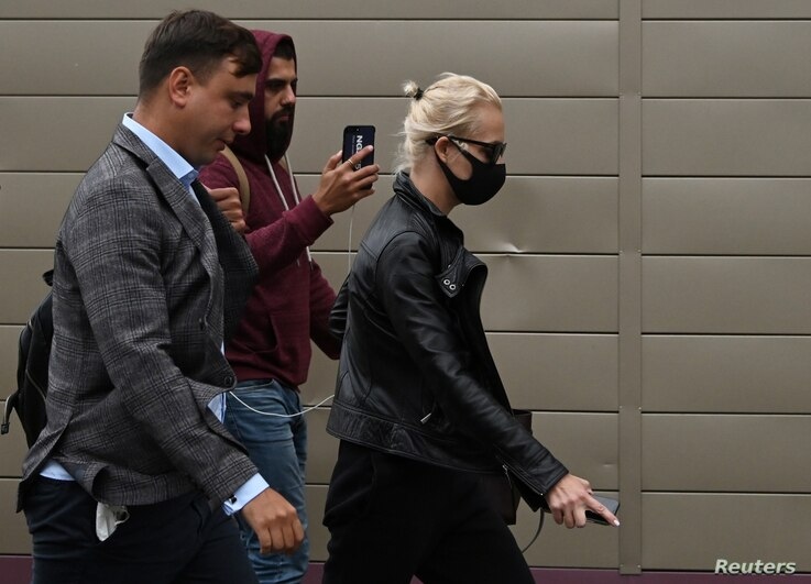 Yulia Navalnaya, wife of Russian opposition leader Alexei Navalny, and opposition politician Ivan Zhdanov arrive at the City Clinical Emergency Hospital Number 1 where Alexei Navalny was admitted in Omsk, Aug. 20, 2020.