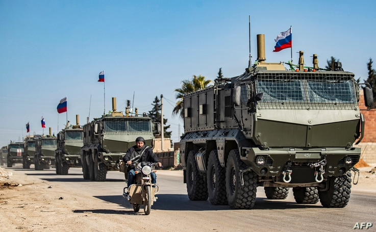 This picture taken on March 9, 2020 in the city of Qamishli in Syria's northeastern Hasakah province, shows Russian military…