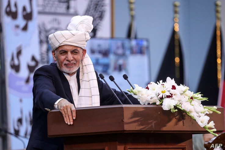 In this handout photograph taken on August 7, 2020 and released by the Press Office of President of Afghanistan, Afghan...