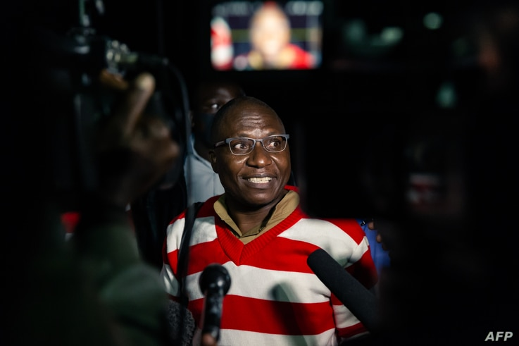 Zimbabwe opposition politician Jacob Ngarivhume, the leader of Transform Zimbabwe, speaks to the press after his release on…