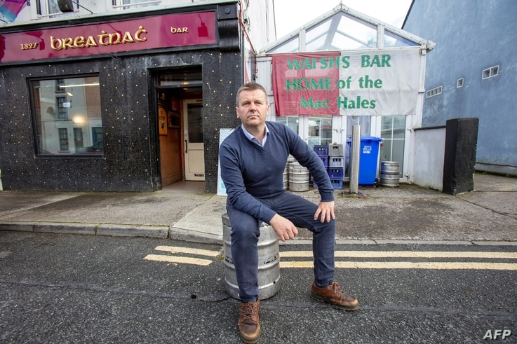 Publican Joe Sheridan poses for a photograph in his closed pub, Walsh's bar, in the rural village of Dunmore, west of Ireland,…