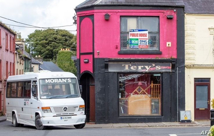 """An estate agent's board reads """"Public House For Sale"""" above the closed-down Tery's bar in the rural village of Dunmore, west of…"""
