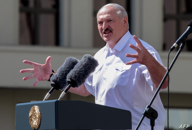 (FILES) In this file photo taken on August 16, 2020 Belarus' President Alexander Lukashenko gestures as he delivers a speech…