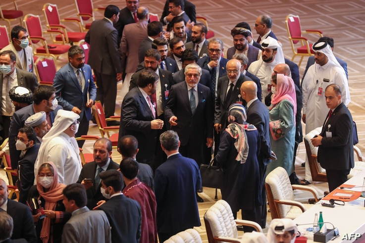 Abdullah Abdullah (C), Chairman of Afghanistan's High Council for National Reconciliation, speaks with members of delegations…