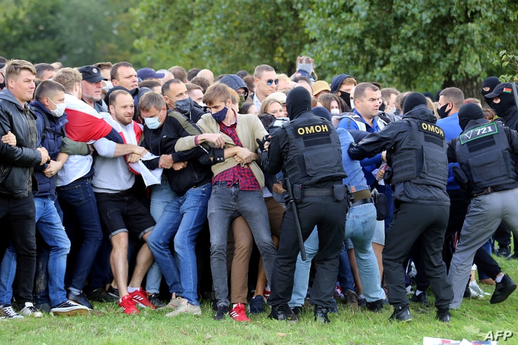 Law enforcement officers detain demonstrators during a rally to protest against the presidential election results in Minsk on…