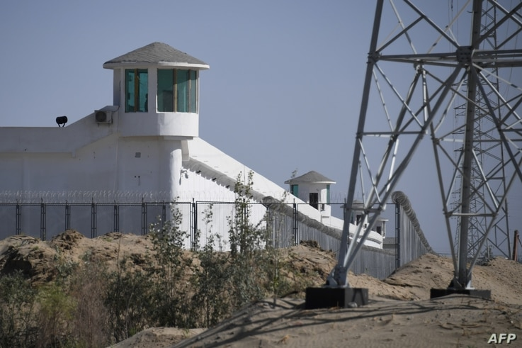 (FILES) this file photo taken on May 30, 2019 shows watchtowers on a high-security facility near what is believed to be a re…