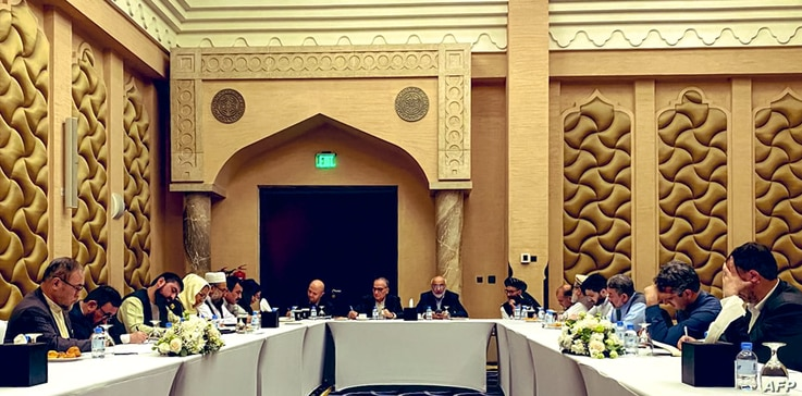 A handout picture provided by the Afghanistan Peace Negotiation Team on September 15, 2020 shows negotiators from the…