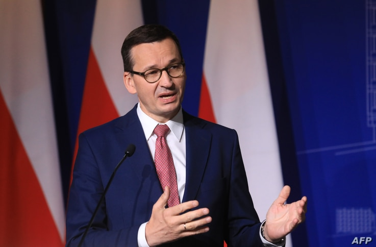 Poland's Prime Minister Mateusz Morawiecki speaks during a joint press conference with Lithuania's Prime Minister after a…