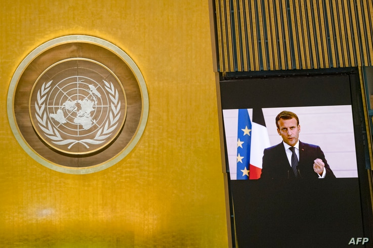 This UN handout photo shows French President Emmanuel Macron as he virtually addresses the general debate of the 75th session…