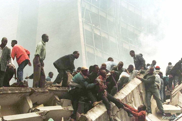 An injured man is removed from the wreckage after an explosion near the U.S. Embassy in Nairobi on August 7, 1998. A jury on…