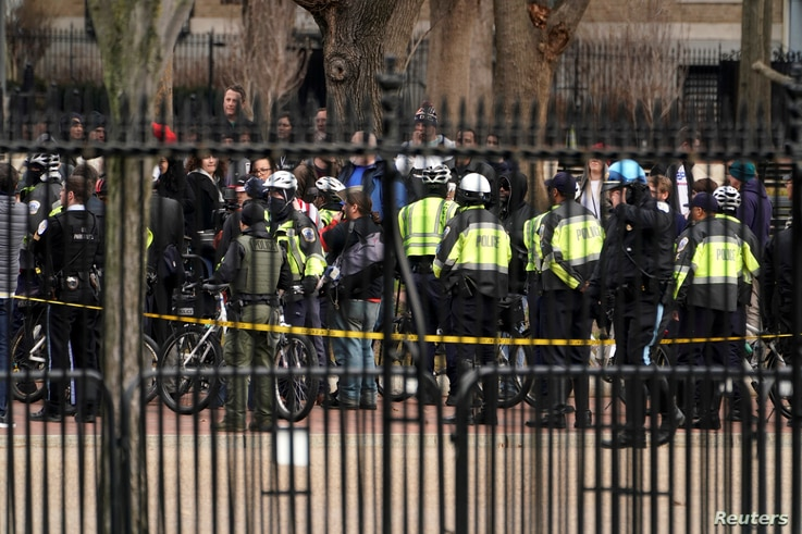 Police keep watch on the group Antifacist Action during a rally outside of the White House in Washington, U.S., January 5, 2019…