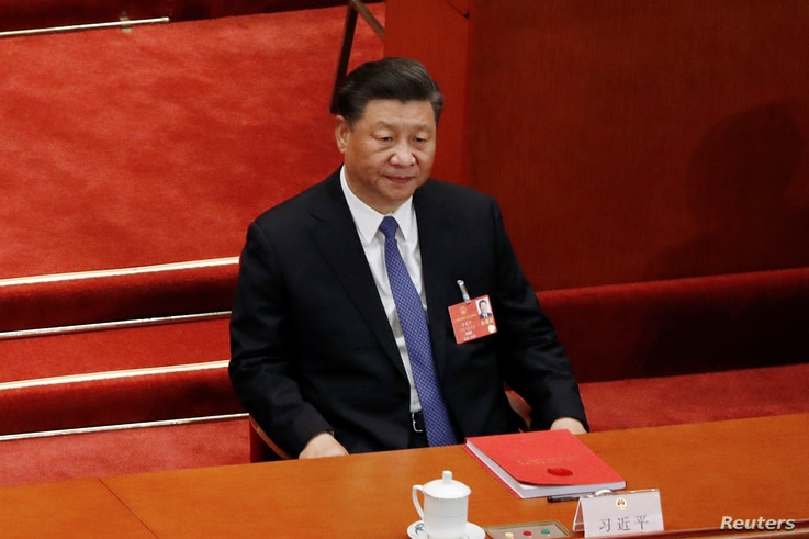 Chinese President Xi Jinping attends the closing session of the National People's Congress (NPC) at the Great Hall of the…