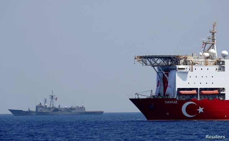 FILE PHOTO: The Turkish drilling vessel Yavuz is seen being escorted by a Turkish Navy frigate in the eastern Mediterranean off…
