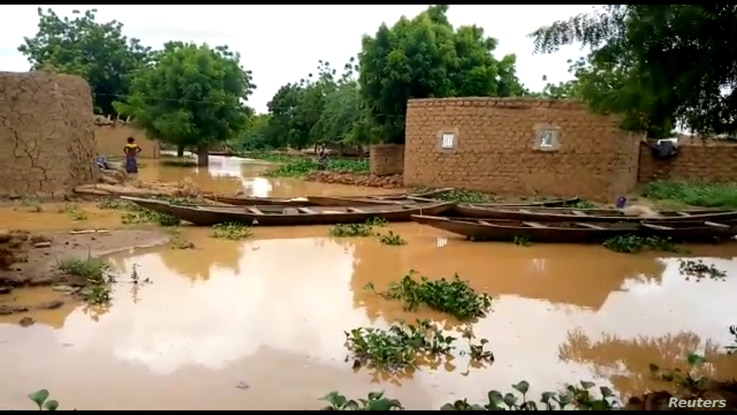 Houses are surrounded by floodwaters in Farie Haoussa, Tillaberi, Niger, August 26, 2020 in this still image taken from a video…