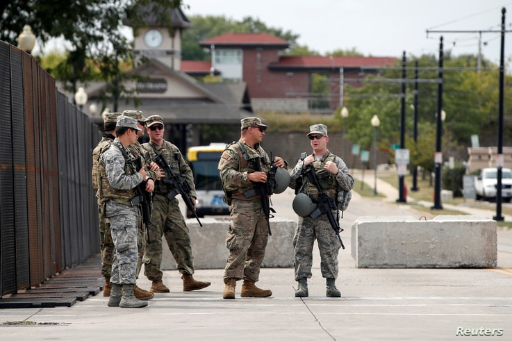 Members of the Wisconsin National Guard stand outside Kenosha County Public Safety Building.