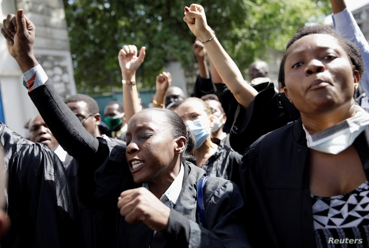 Lawyers chant slogans as they march to demand justice after the killing, on Aug. 28, of the lawyer and President of the Bar.
