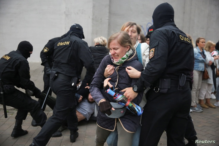 Law enforcement officers scuffle with demonstrators during a rally in support of detained Belarusian opposition leader Maria…
