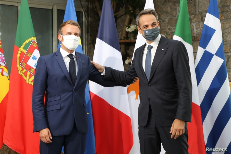 French President Emmanuel Macron welcomes Greece's Prime Minister Kyriakos Mitsotakis ahead of the plenary session of the MED7…