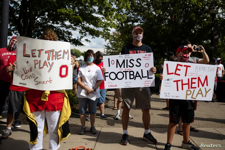 FILE PHOTO: Fans attend a protest, staged by parents of Ohio State football players, against the cancelation of the Big Ten…