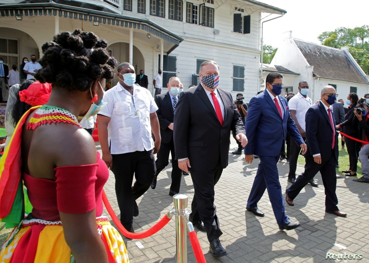 Suriname's President Chan Santokhi and U.S. Secretary of State Mike Pompeo walk together, in Paramaribo, Suriname September 17,…