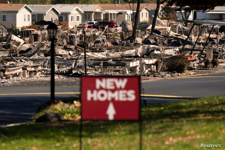 A sign advertising new homes stands in a neighborhood severely damaged by wildfire in Medford, Oregon, U.S. September 20, 2020…